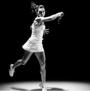 Simona Halep in Wimbledon whites with a cross back by Adidas