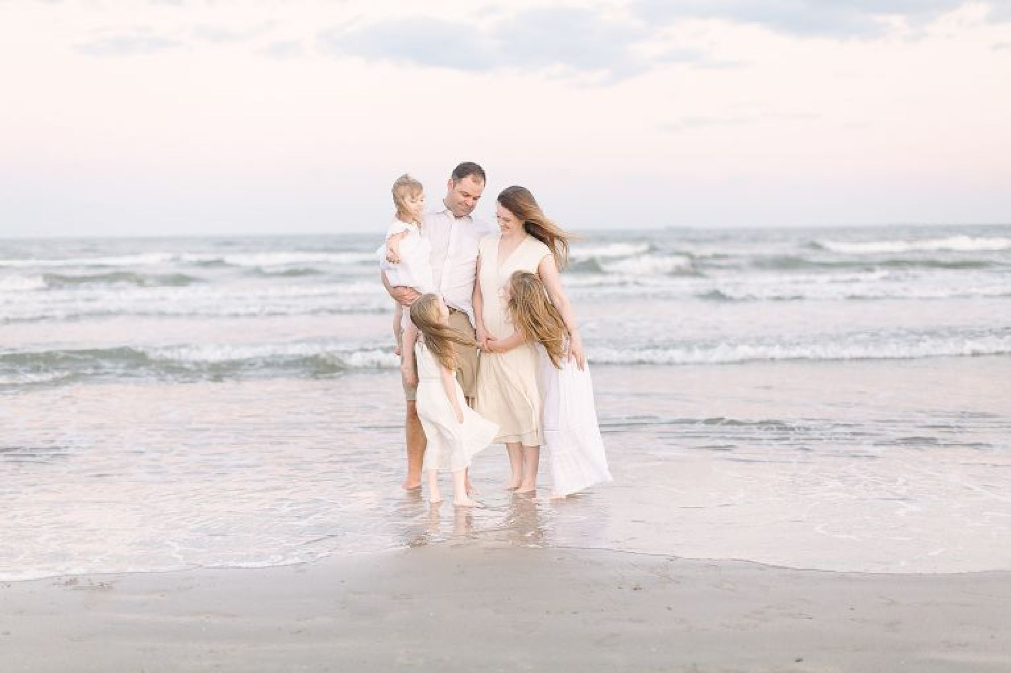 Sunset family session on the beach in Galveston, TX | Photo by Courtney Griffin Photography