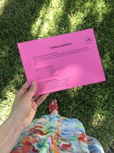 feet in grass with walking meditation guide