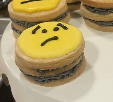 this is a cookie with a sad and worried face