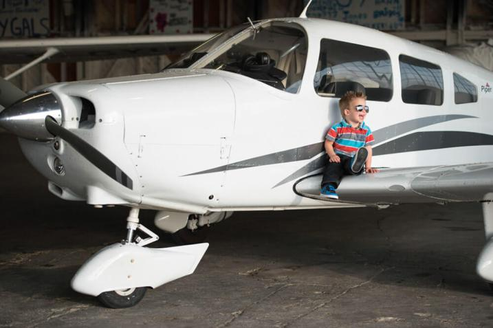 Jace on a plane at the Regina Flying Club