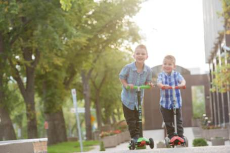 Brothers on scooters in Downtown Regina - Favel Family Photos 2016