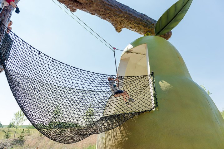 Zip-lining from the Orchard Treehouse into the pear at Granary Road