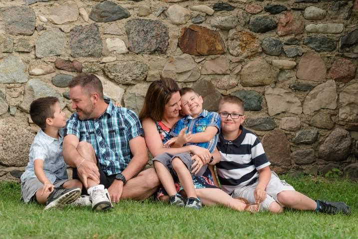 Family snuggling on a farm near Regina Saskatchewan