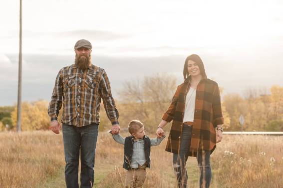 Keen family walking hand in hand in the Lumsden fall