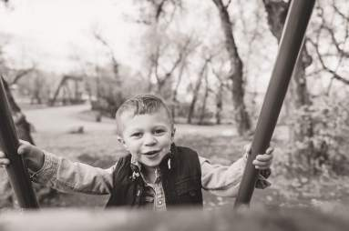 Little boy climbing up the slide stairs in Lumsden