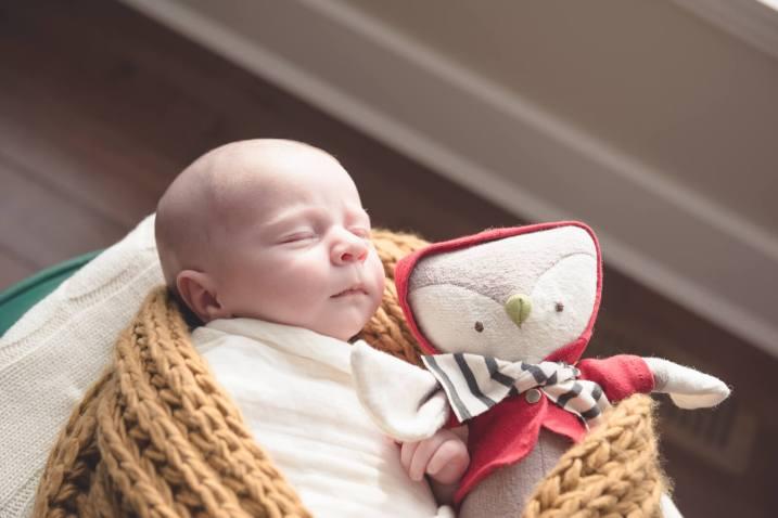 Regina Newborn Photographer - Shepherd with Stuffed Animal