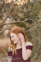 Alisha with her engagement ring amongst trees at Wascana Trails copy