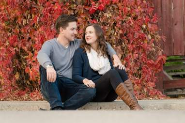 Couple in front of red leaves