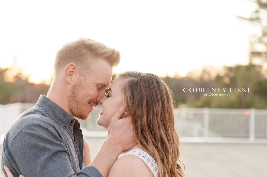 Couple share a moment together as the sun sets
