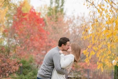 Couple sharing a fall kiss in Wascana Park Regina