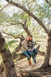 Couple sitting in willow tree near Wascana Park