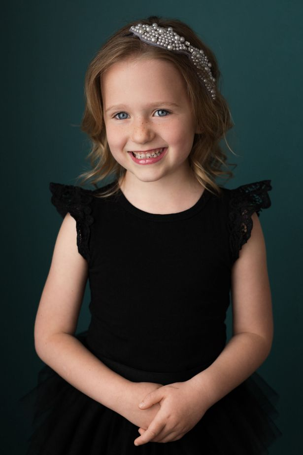 Little girl in black tutu dress with headband