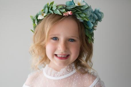 Little girl in green floral crown