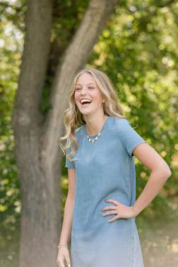 Teenage girl in chambray dress in the park