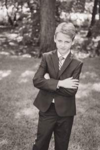 Tween poses for photo in his suit in Regina