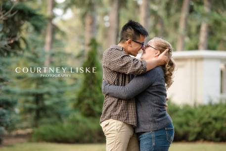 Couple embrace during their Regina engagement session with Courtney Liske Photography