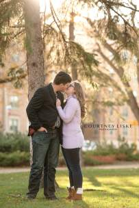 Couple kisses in Victoria Park downtown Regina