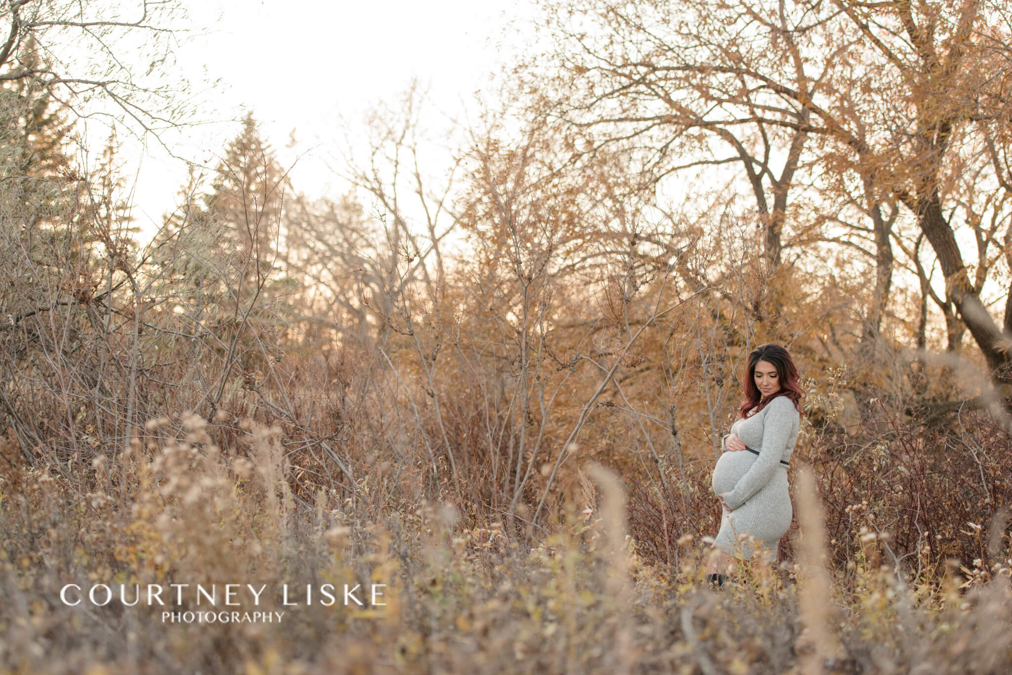 Mother in knit fitted dress in golden field
