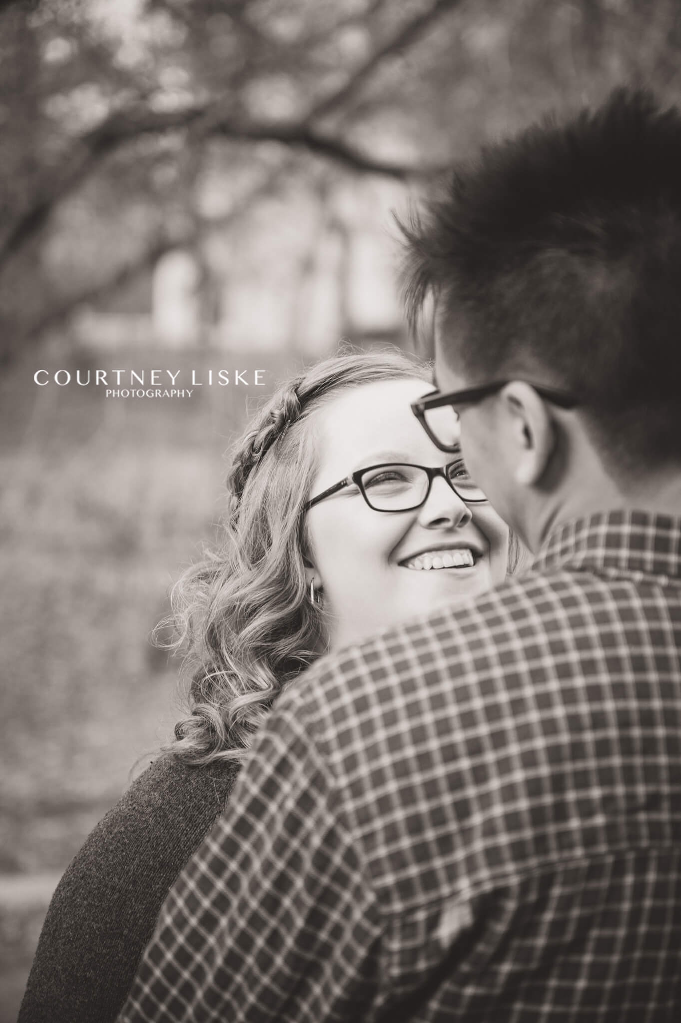 Woman in glasses smiles at her fiancee
