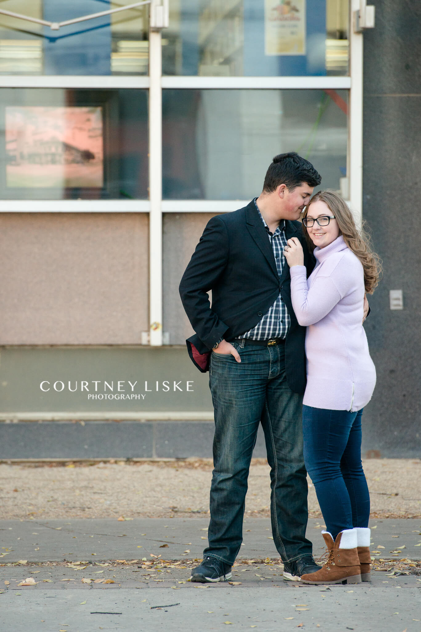Luke Tori Engagement Courtney Liske Photography Blazer Black Woman In Purple Sweater And Man A Stand Together Outside The Regina Public