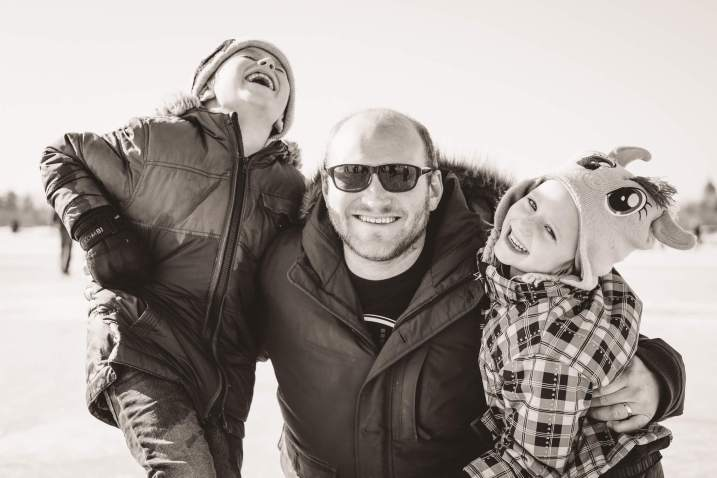 Father with his two kids laughing at Waskimo Winter Festival 2017