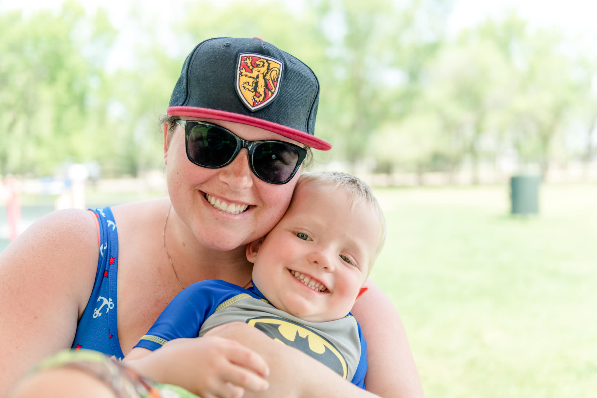 Woman in Gryffindor hat with son in Warman