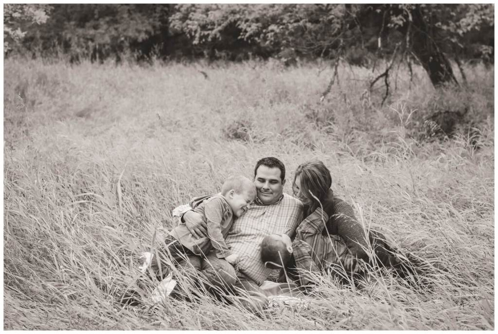 Regina Family Photographer - Favel Family - Kyle-Richelle-Ty-Jace - Wakamow Valley Park - Moose Jaw - Sitting in tall grass