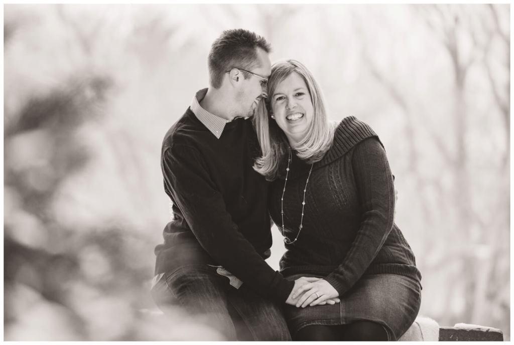 Regina Engagement Photographer - Dave-Sarah - Winter Engagement Session - Kiwanis Park Regina - Couple sitting on blanket
