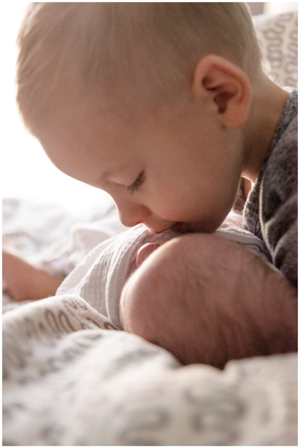 Regina Family Photographer - Jensen Newborn - Jensen-Kayden - In home Family Session - Kisses from big brother