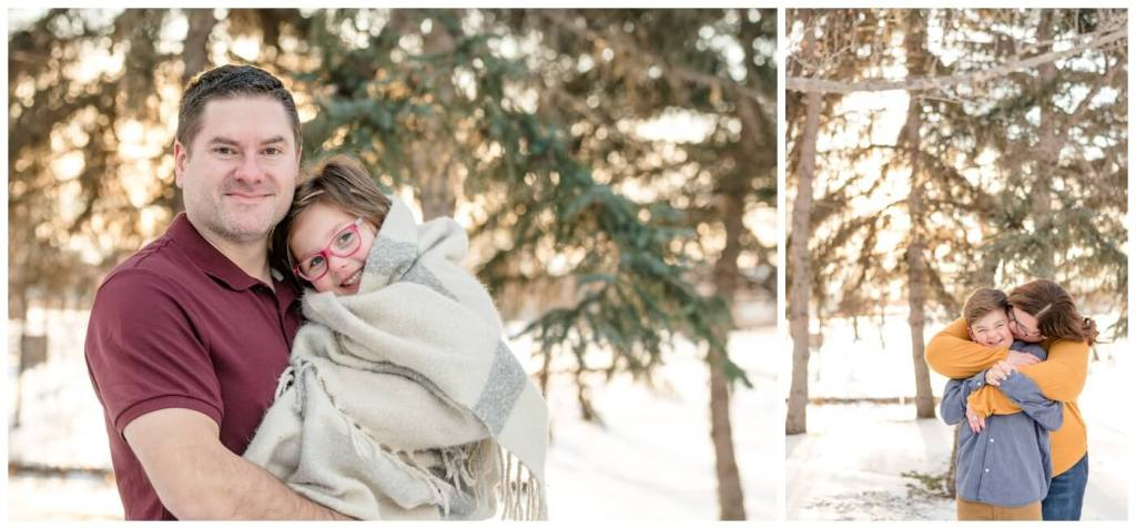 Regina Family Photography - Goudy Family - Winter Family Session - Snow - Candy Cane Park - Father holding daughter in white blanket