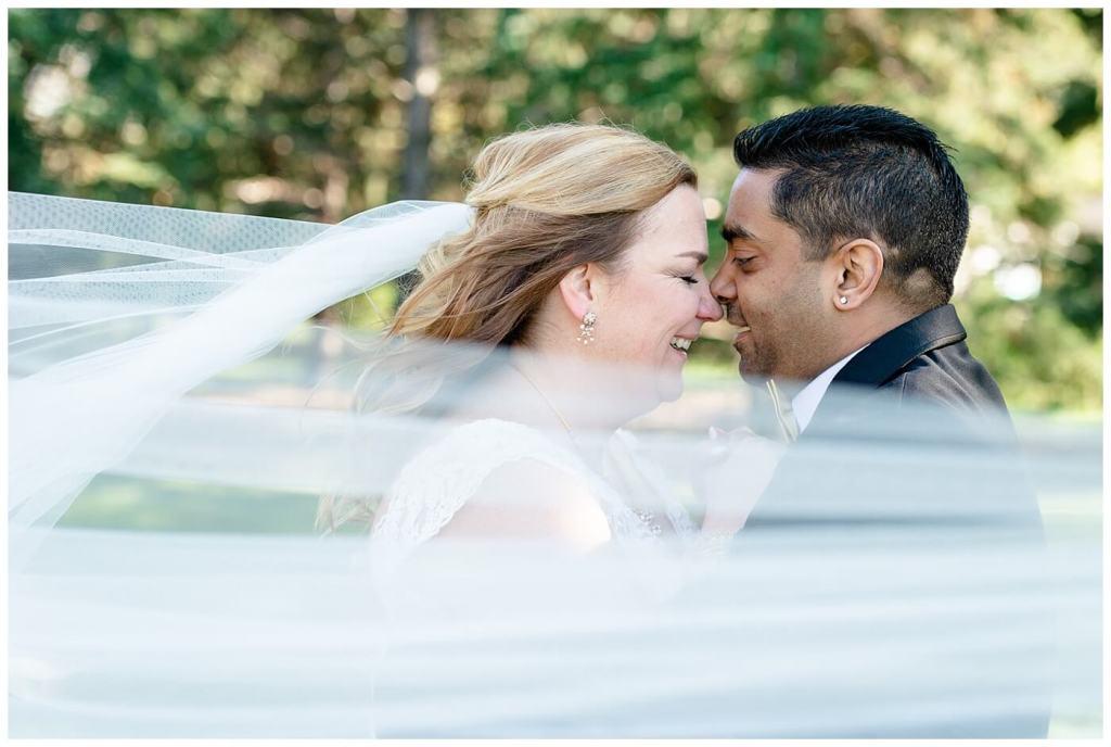 Regina Wedding Photographer - Nishant - Corrina - Les Sherman Park - First Look - Bride & Groom through Chapel length veil
