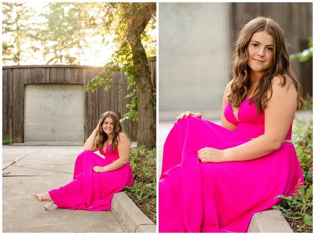 Regina Family Photography - Georgia Graduation 2020 - Summer Graduation Session - Girl in vibrant pink dress sitting on curb near wooden building