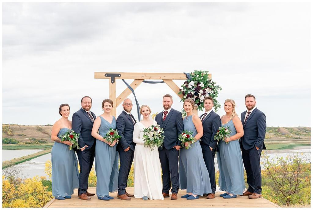 Regina Wedding Photography - Tyrel - Allison - Bride & Groom with bridal party - Groom in Navy Blue suit - Bridesmaids in periwinkle blue