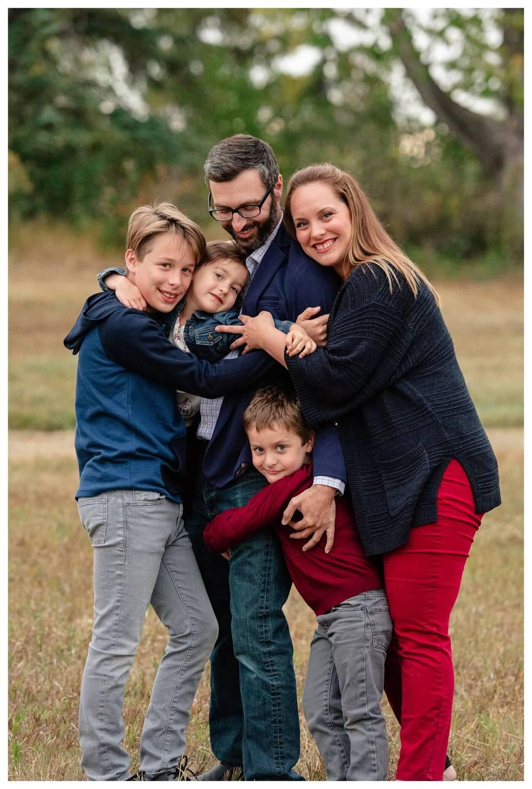 Schlamp Family 2020 - 010 - Regina Family Photographer - Family hugging