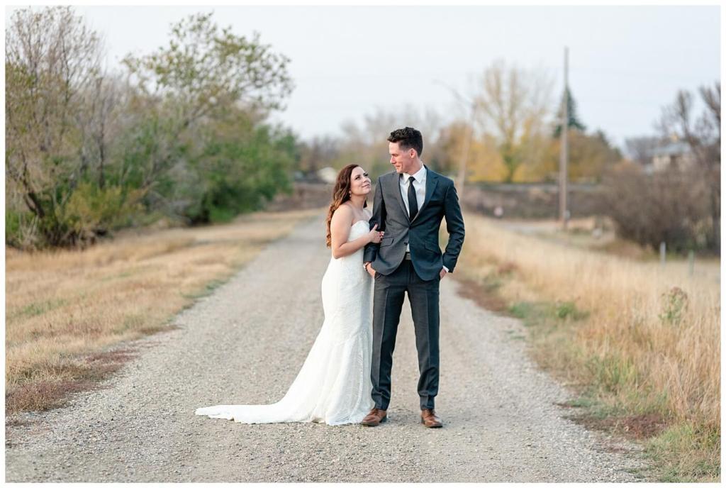 Regina Wedding Photographer - Tim & Jennelle At Home Wedding - Sunset Portraits on a grid road