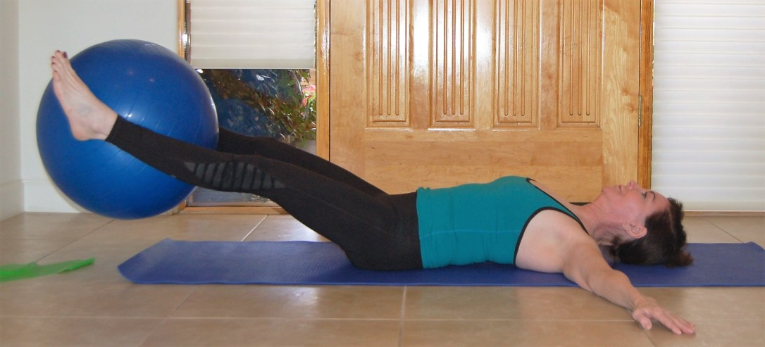 leg lifts with exercise ball