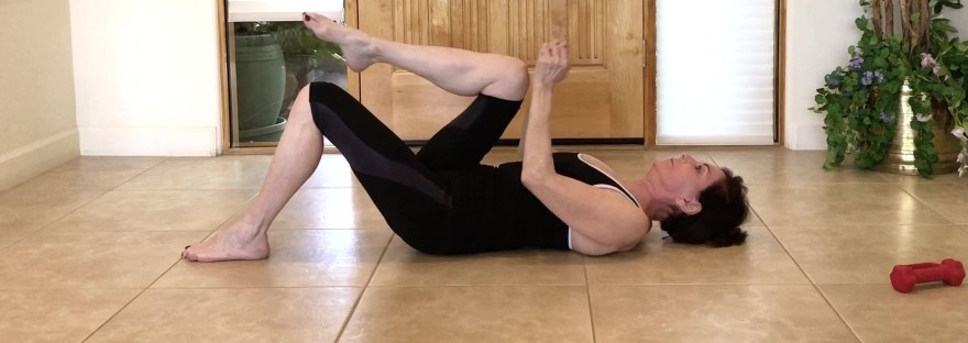Core and shoulder extension using weights