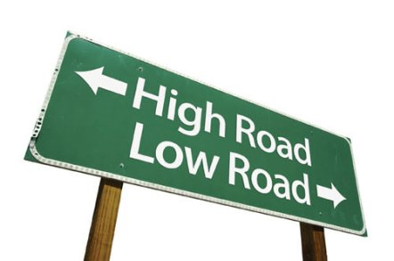 """Sign showing """"high road"""" and """"low road"""" symbolizing the importance of good conduct in the courtroom"""