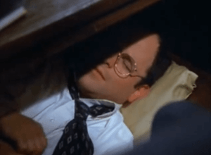 Seinfeld's George Costanza napping under his office desk