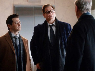 Scene of three men talking from Bull TV series