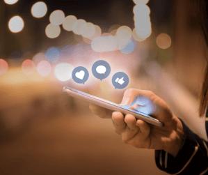 man posting to social media on smartphone