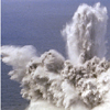 Thumbnail showing exploding spray of water during test of depth charges from USS Arkansas.