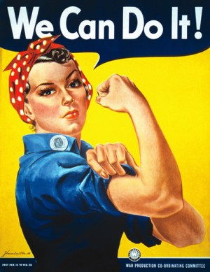 "Rosie the Riveter with slogan "" We Can Do It. "" Woman with red and white polka dot kerchief on head, blue work shirt, fist raised, showing muscle, in front of yellow background."