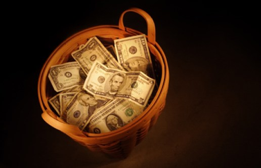 basket of money illustrating book about Surplus Moneys Proceedings in Foreclosure Actions under RPAPL Section 1361 by Richard Klass