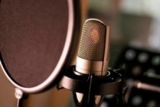 Microphone with pop shield