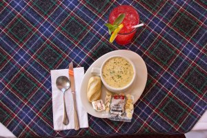 Bowl of Soup with a Breadstick, Crackers and Raspberry Lemonade