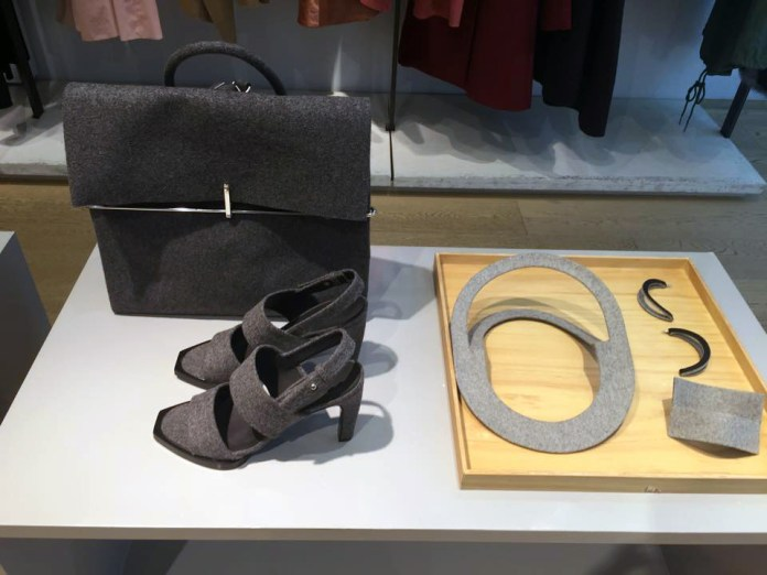 Wool backpack, heeled sandals, earrings, cuff and necklace