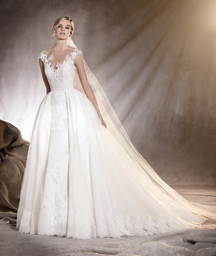 Long tailed wedding dress with lace by Adela B