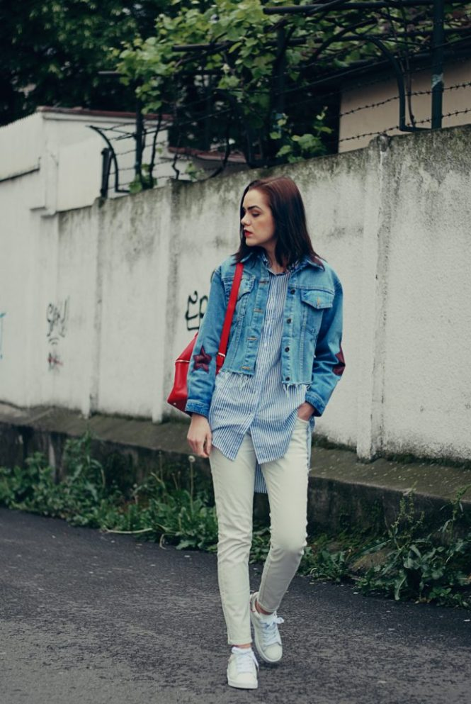 Denim jacket, striped shirt, white jeans, white sneakers, red backpack, spring outfit by Andreea Birsan